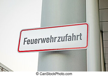 Fire rescue path Feuerwehrzufahrt - Sign labeled with...