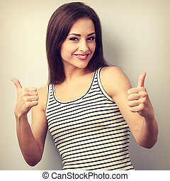 Happy succesful young casual woman showing thumb up sign...