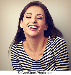 Happy natural toothy laughing casual woman with wide open...