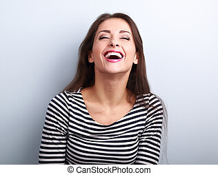 Happy natural laughing young casual woman with wide open...