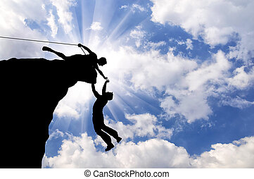 Silhouette of two climbers - Concept of aid. Silhouette of...