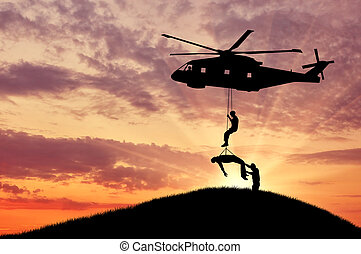 Silhouette helicopter evacuated person - Concept of the...