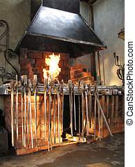 smithy - Interior of a smithy with tools and fire