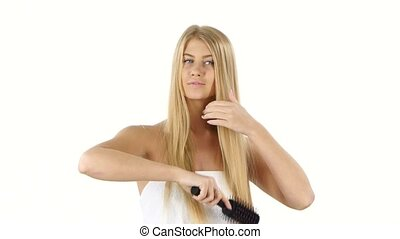 Hair. Beautiful Blond Brushing Her Hair. Hair Care, bathroom...