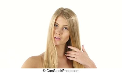 Hair. Beautiful Blond Brushing Her Hair. Hair Care. Close...