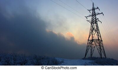 Power Lines. - Time lapse of running clouds with electricity...