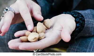 male hands rubbing almonds