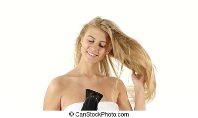 woman in bathroom drying hair with blow dryer, bathroom -...