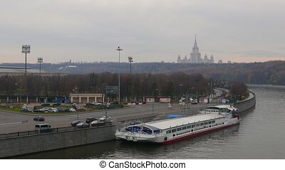 View on Moskva River, Vorobievy Hills and ship above whem, establishing shot
