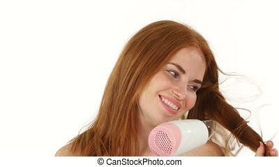Smiling young Redhead girl singing white hair dryer,...