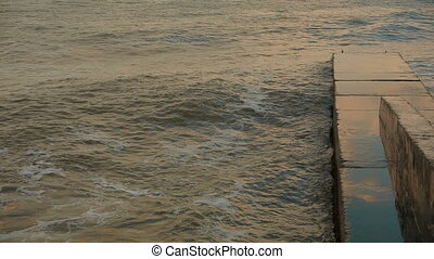 Stony Pier Washed By Sea Waves - In the frame there is a...