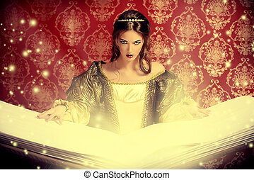 magic book - Fairy beautiful witch reads magic book of...