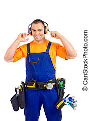 profession - An industrial worker wearing uniform and tools...