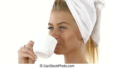 smiling girl is drinking coffee Close up, bathroom -...