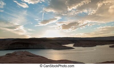 Lake Powell Sunset Time-lapse - Moving clouds and boats lake...