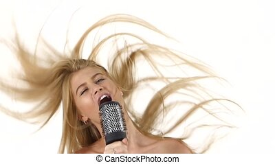 sexy girl singing and dance using a brush as a microphone. slow motion. close up, bathroom