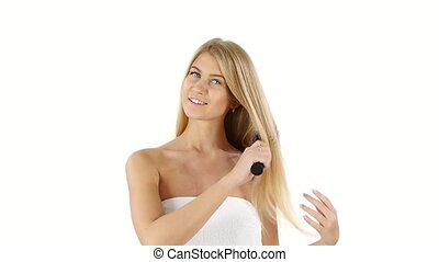 Beautiful woman with long straight blond, Brushing Her Hair,...