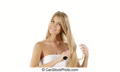 woman with long straight blond, Brushing Her Hair, slow...