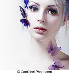 Beautiful Girl With  Butterfly. Beauty Face. Creative Make up and colored lenses.