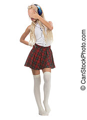Lovely sexy blonde girl in checkered short skirt with...