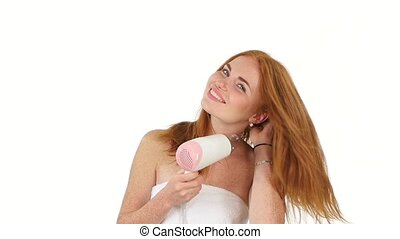 Smiling young Redhead girl singing while blow-dry. Close up....