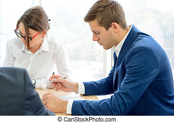 Business People Signing the Contract around the Table in Modern Office. Business Cooperation Concept