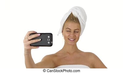 woman with a towel on her head takes selfie. Close up. slow...