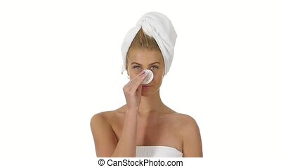 Beautiful young shirtless woman wiping her face with sponge....