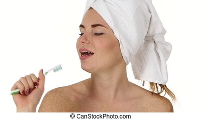 pretty woman singing to tooth brush. Close up, slow motion
