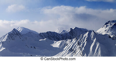 Panoramic view on snowy mountains in clouds Caucasus...