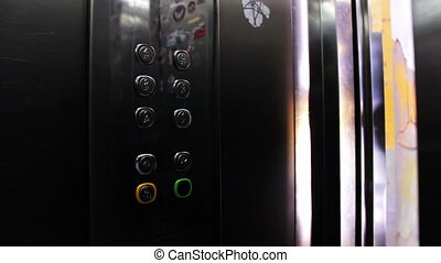 Presses a Button In An Elevator And Lift - People inside the...
