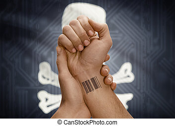 Barcode ID number on wrist of dark skinned person and flag...