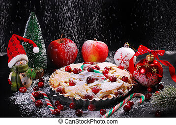 apple pie with cranberry for christmas in winter scenery -...