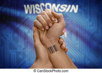 Barcode ID number on wrist of dark skinned person and USA...