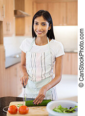 indian woman preparing diner - pretty indian woman preparing...