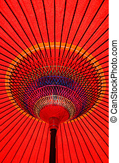 Colorful Red Parasol Underneath - Looking up at a colorful...