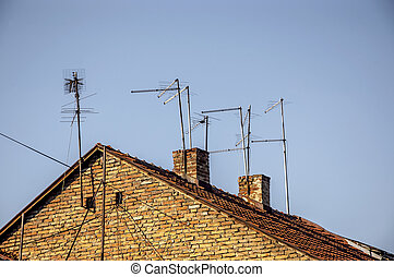 Analog tv antenna - analog tv antenna on the old roof with...