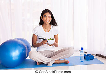 indian woman eating healthy salad - attractive indian woman...