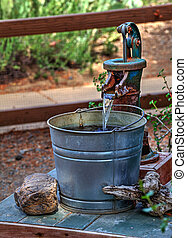 The Old Water Pump - Water flows from an old hand water pump...