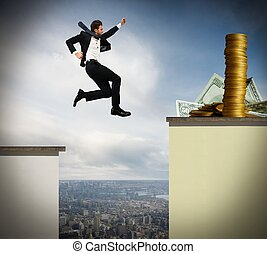 Face the risk for motivation - Determined businessman jumps...