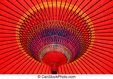 Red Parasol Underneath - Looking up at a colorful red...