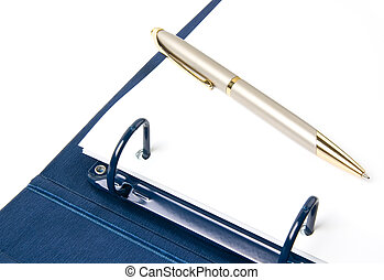 blue ring binder and pen - opened ring binder and pen on a...