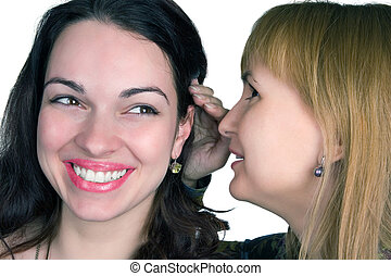 The gossip - Woman whispering into the ear of a another...