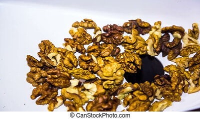 Pilled Walnuts Falling Into Mincing Machine - CLOSE UP SHOT:...
