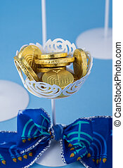 Hanukkah decoration with chocolate gelt coins - Close up of...