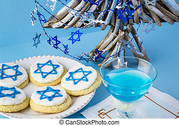 Hanukkah cookies and blue cocktail. - Close up of cookies...