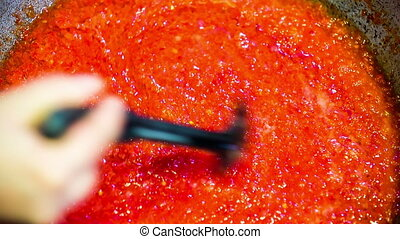 Cook Adding Spices Into Red Sauce - CLOSE UP shot form above...