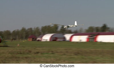 View of glider climbs over the airfield - View of sailplane...