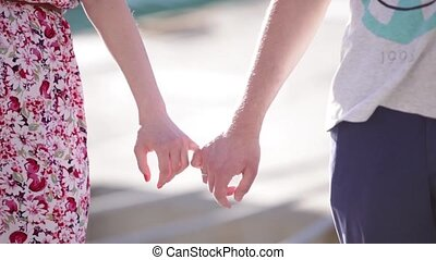 hands holding on to little fingers
