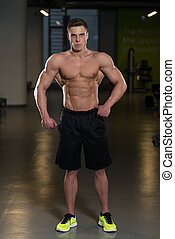 Portrait Of A Physically Fit Young Man - Portrait Of A...